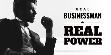 Handsome young man in suit with text real businessman and real power