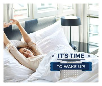 Woman in cozy bed in morning