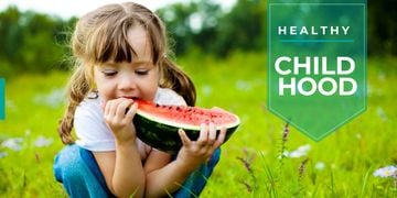 cute little girl eating watermelon slice