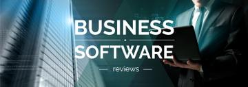 Business Software Review Man Typing on Laptop