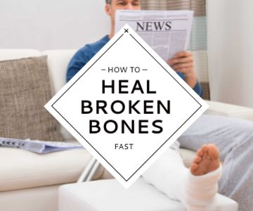 Man with broken bones sitting on sofa reading newspaper