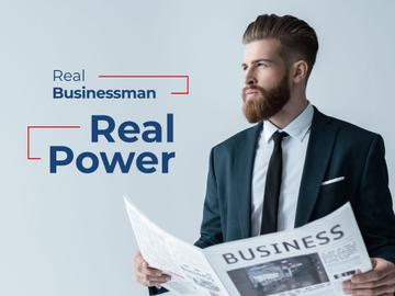 Handsome Businessman holding newspaper