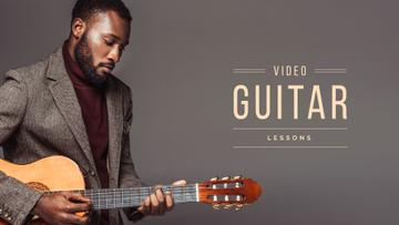 Video guitar lessons with young man playing guitar