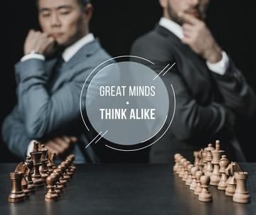 Quote on Chess table in front of Businessmen