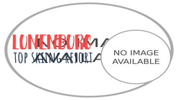 Mountain Resort Ad Skier Riding in White