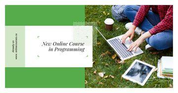 Man working on laptop on Grass