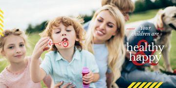 Parents with Kids Blowing Bubbles