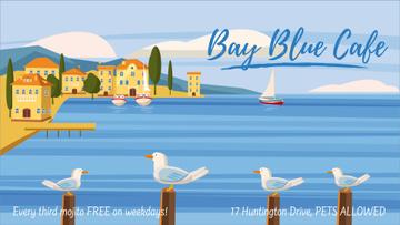 Seagulls at pier in Mediterranean town