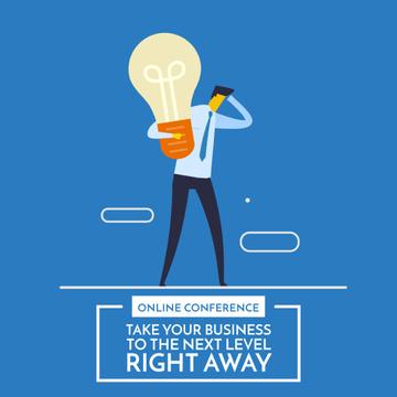 Businessman holding light bulb