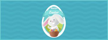 Easter bunny with colored eggs in basket