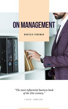 Businessman by Shelves with Folders