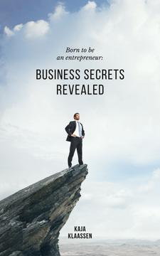 Confident Businessman Standing on Cliff