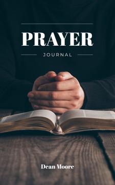 Man Praying by Bible