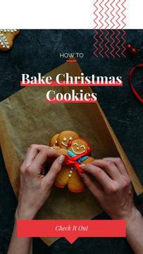 Woman decorating Christmas ginger cookies