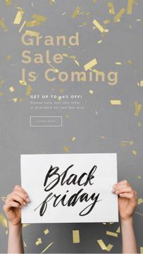 Black Friday Sale Placard in Hands Under Confetti