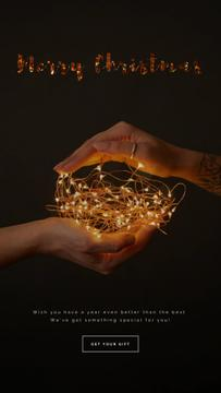 Christmas Greeting Hands Holding Garland