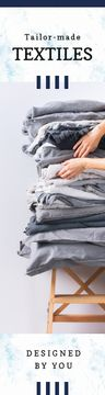 Woman Choosing Home Textile in Grey