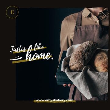 Baker holding Bread Loaves