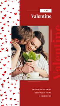 Man kissing woman with flowers on Valentine's Day