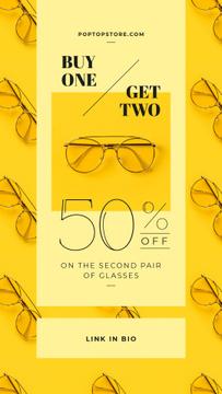Aviator glasses on yellow background