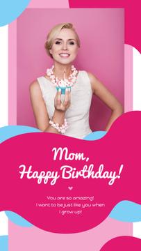 Woman holding birthday cupcake