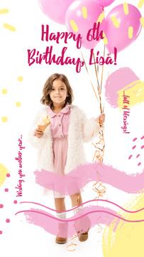Girl holding Birthday balloons