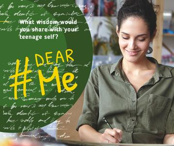 Smiling woman writing in diary