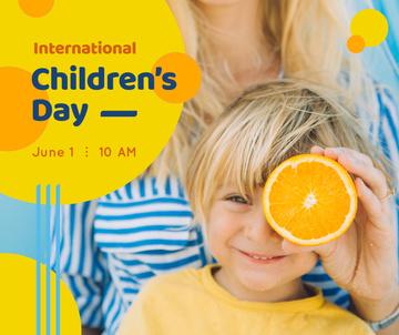 Smiling kid holding orange on Children's Day