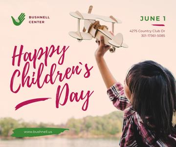 Child playing with toy plane on Children's Day