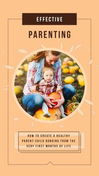 Mother with Her Daughter with Pumpkins in Autumn