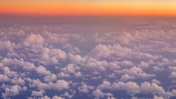 Flying over Clouds in Sky